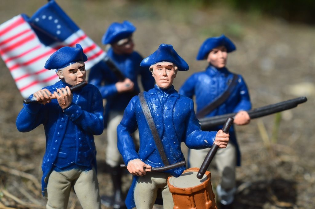 image of wax figures carrying military flag and drums