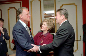 2/5/1981 President Reagan Nancy Reagan and Billy Graham at the National Prayer Breakfast held at the Washington Hilton Hotel
