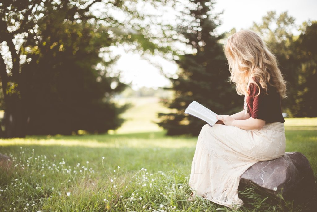 Image of a person reading a book
