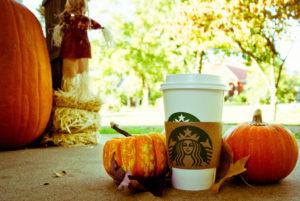 image of pumpkin spice latte and pumpkins