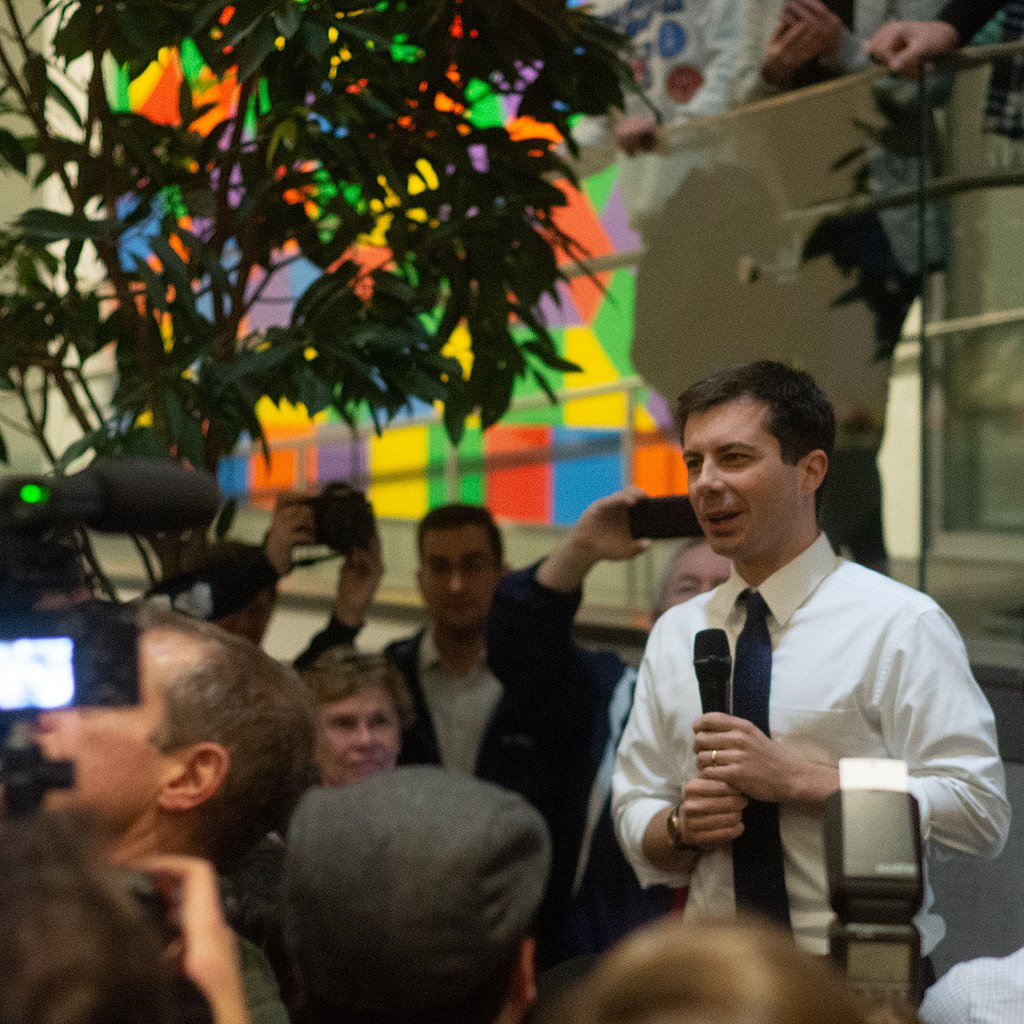 image of Pete Buttigieg - Presidential Candidate - holding a microphone in a crowd