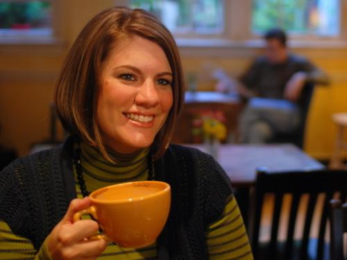 image of Rachel Held Evans drinking coffee and smiling