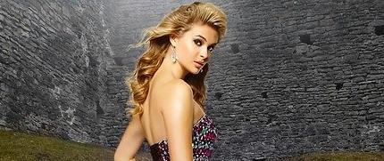 image of blonde woman looking at camera