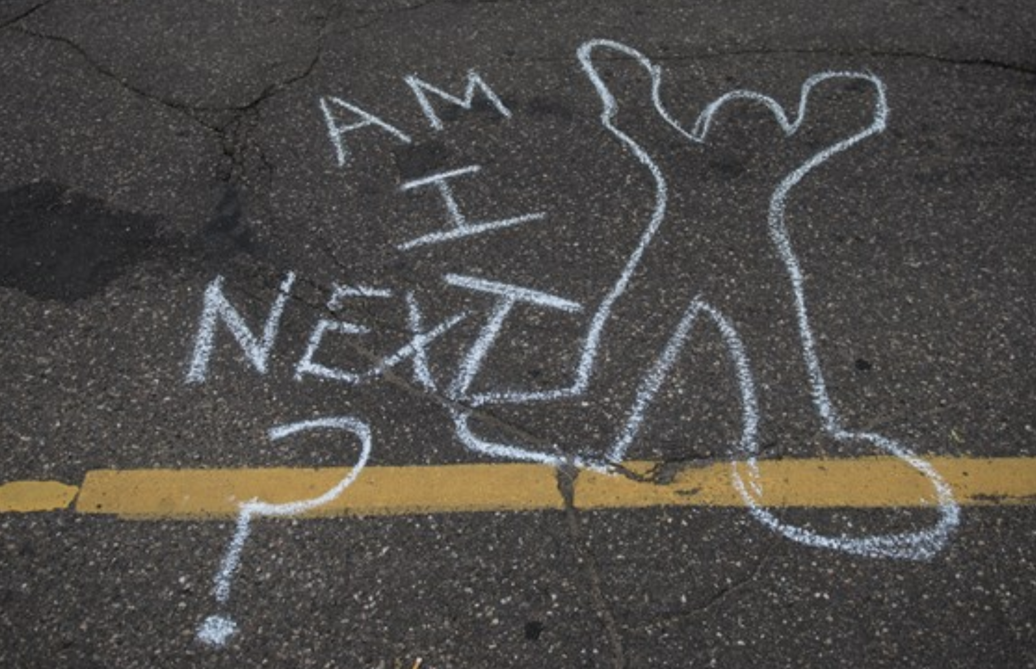 chalk outline of a body on the street with the words 'Am I next?'
