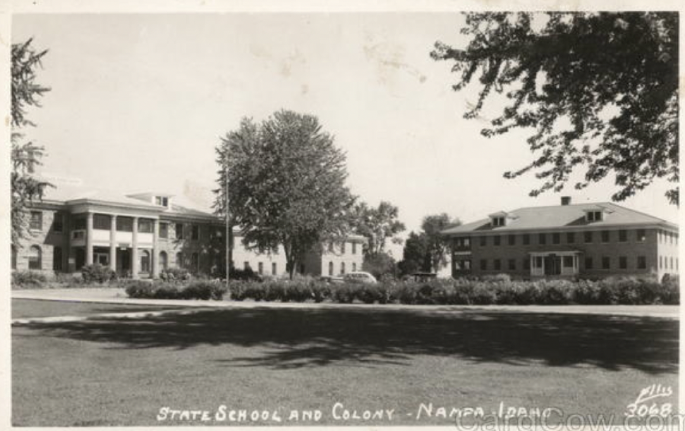 A black and white photograph of the Idaho State School and Colony in Nampa, ID