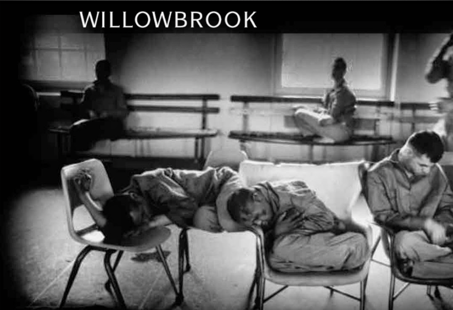 Black and white photograph of five residents in Willowbrook. Two are in the background sitting near windows. Three are in the foreground and look to be attempting to sleep on chairs in a barren room.