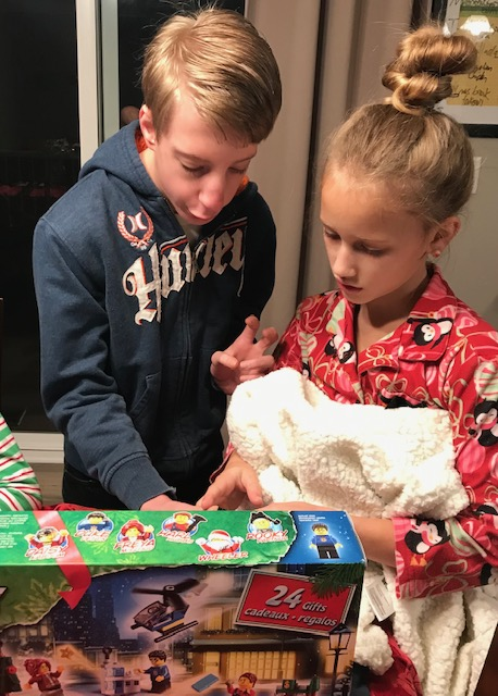Two kids, looking at a lego advent calendar